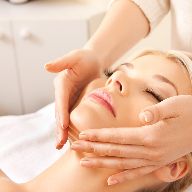 picture of calm beautiful woman in massage salon (focus on hands)